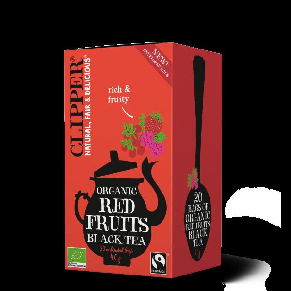 Luomu musta tee ja punaisia marjoja